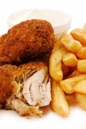 coated: close up of crunchy breaded southern fried chicken with fries
