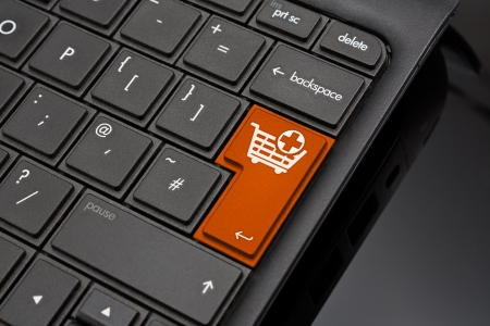 amended: Add to Basket Return Key symbolizing the selection of products for final purchase at an online shop