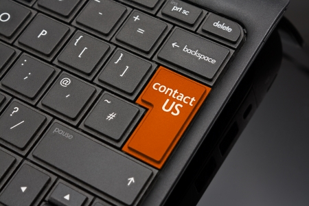 Contact us Return Key symbolizing a call to action request for further information from a website on the internet Stock Photo - 16493213
