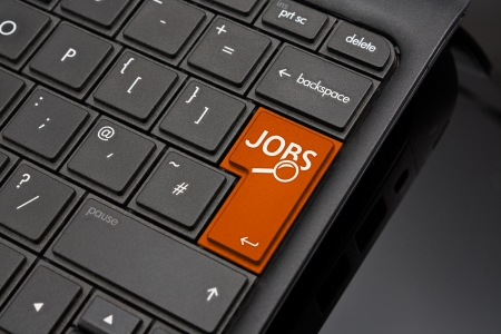 amended: Job search Return Key symbolizing the searching of internet recruitment websites to find work or a job by an applicant