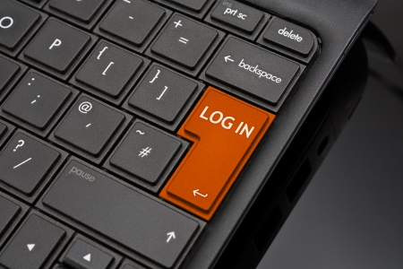Log in Return Key symbolizing the logging in to an account online after entering username and password Stock Photo - 16493207