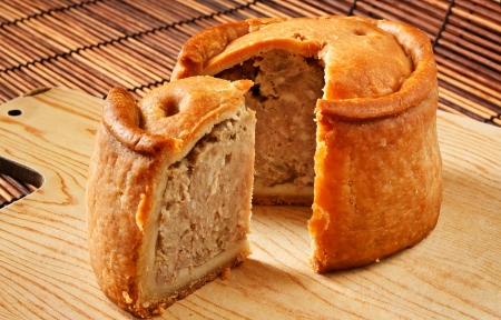 A traditional handmade pork pie traditionally called Melton Pies from the town of Melton Mowbray in the Midlands, England