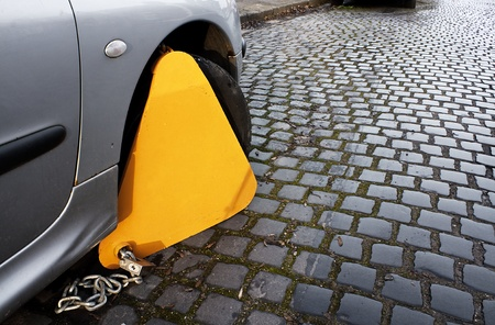 Car with clamp on to immobilize movement as a penalty to an offence such as no tax Stock Photo - 16908702