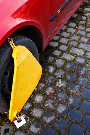 immobilize: Automobile Wheel Clamp on parked car Stock Photo