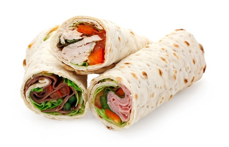 chicken sandwich: A sliced tortilla wrap a rollup of flatbread with assorted fillings