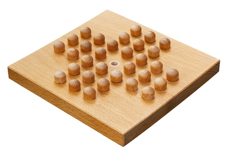 wooden peg solitaire board crafted from wood a popular indoor puzzle Stock Photo