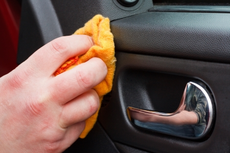 car cleaning: Cleaning the car interior with polishing cloth