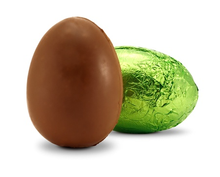 unwrapped: chocolate easter eggs one still wrapped in foil a western custom given to children as gifts Stock Photo