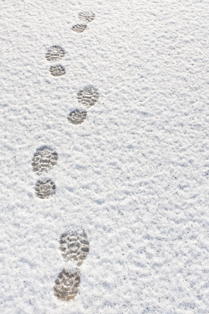 Footprints in fresh snow background great concept for winter footwear photo