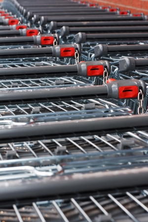 unbranded: Rows of unbranded shopping trollies at the supermarket Stock Photo