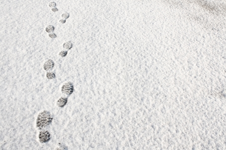 flurry: Footprints in fresh snow background great concept for winter footwear Stock Photo