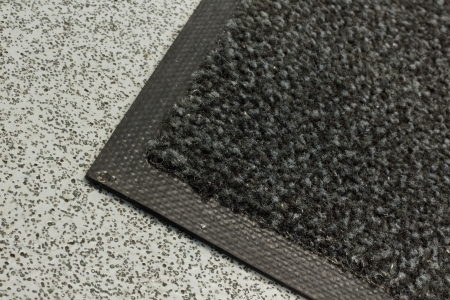 Industrial mats often rented to keep dust levels down in commercial business buildings, warehouses or anywhere with polished, plastic or sealed floors photo
