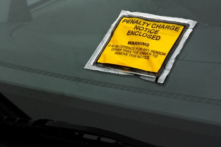 Parking ticket stuck on car windscreen a penalty or fine Stock Photo - 17800716
