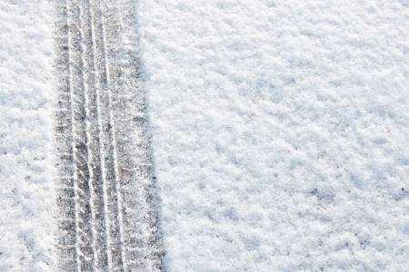 4wd: tyre tracks imprinted into fresh snow a great background for rallies or four wheel drive carsty