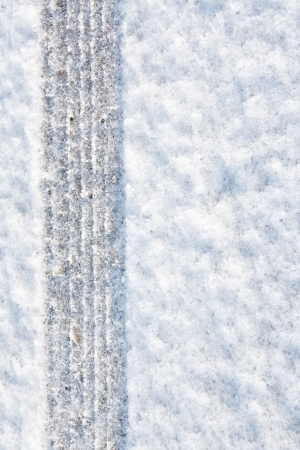 tyre tracks imprinted into fresh snow a great background for rallies or four wheel drive carsty Stock Photo - 17800711