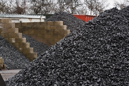 coal fired: Coal yard with supply in heaps for domestic use
