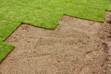 partially layed turf making good border for landscaper or gardening business photo