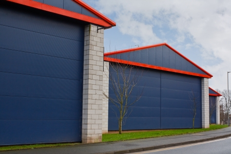 units: Close up of steel cladded units and commercial buildings at generic industrial estate