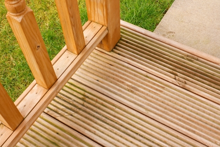 Corner profile of wooden garden decking a popular feature outside modern homes photo
