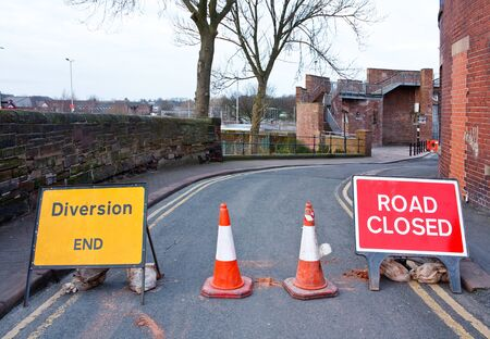 road block: Road closed signs on a small street in the uk to stop cars and keep workmen safe