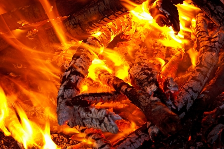 ember: natural wood log fire embers glowing great for background or in solid fuel stoves now classed as a renewable power source Stock Photo