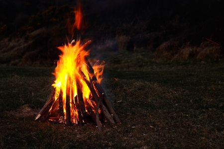 Roaring bonfire of real wood collected at the beach and in full blaze with dark background for copy Stock Photo - 18420565