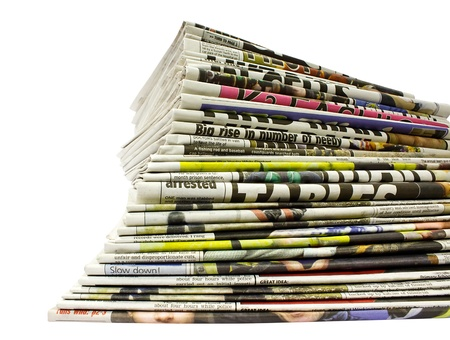 broadsheet: collection of different color newspapers stacked in pile isolated on white