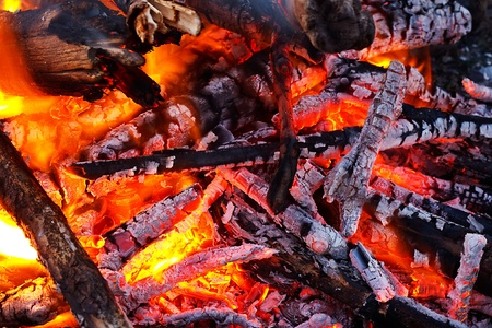 natural wood log fire embers glowing great for background or in solid fuel stoves now classed as a renewable power source Stock Photo - 18990120
