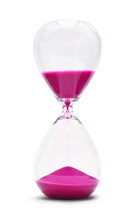 An hourglass showing the sands of time passing cut out on a white background photo