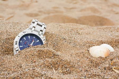 mishap: wristwatch left discarded at the beach great for lost property or travel insurance Stock Photo