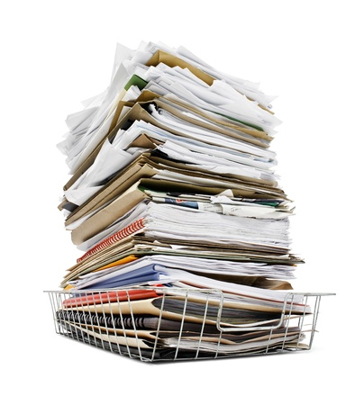 workload: office in tray piled high with a large amount of overwhelming work good concept for stress
