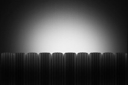 huellas de neumaticos: fila de neum�ticos radiales y transversales para que el fondo de un garaje de venta de neum�ticos Foto de archivo