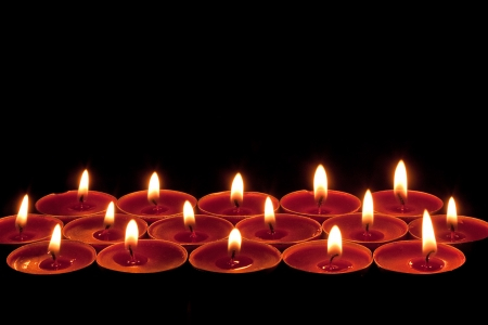 lit collection: red candlelight edging or border on a black background