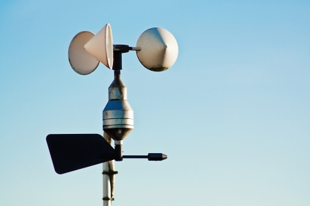 Anemometer on weather station measuring wind speed for climate change trends and forecasting photo