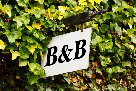 Traditional Bed and breakfast sign surrounded by an ivy creeper