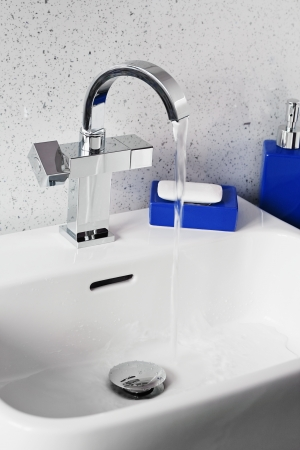 Mixer tap on a contemporary modern bathroom sink Stock Photo - 19976733