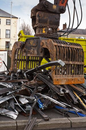 Scrap metal waste of iron and aluminum for recycling at a demolishion site photo