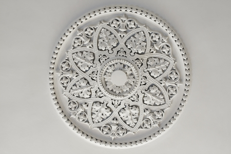 Old antique plaster ceiling plate or rose in an old victorian house