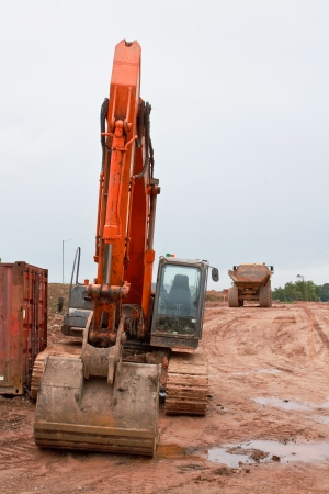 Large industrial digger at a new road construction site clearing away the countryside to create a flat surface ready to lay the new highway photo