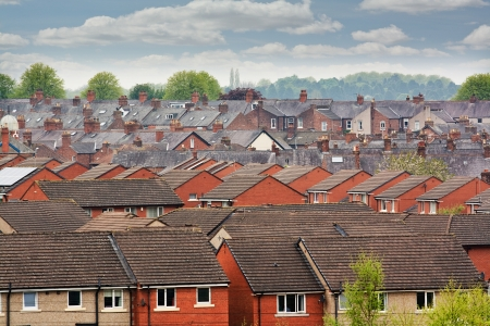 english famous: Urban scene across built up area showing the slate roof tops of terraced houses on an old housing estate Stock Photo
