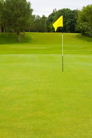 golf course: Golf course with large area for text including the flag and fairway a general golfing scene with no people Stock Photo