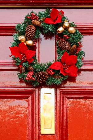 door leaf: Festive Christmas wreath on door at Christmastime