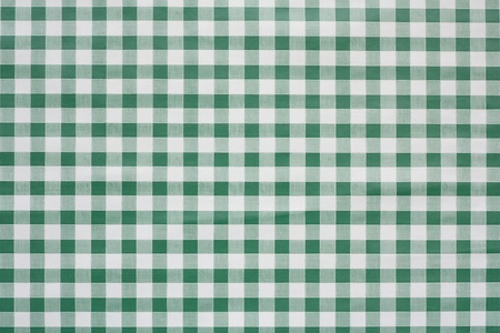 often: Green gingham tablecloth often found in diners and cafes a popular traditional covering for tables where food is consumed