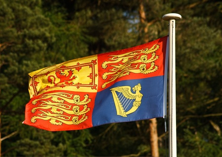 standard: The Traditional Royal Standard flag which is flown when the queen of England is in residence at Buckingham Palace, Windsor Castle or elsewhere