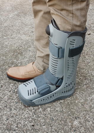 strapped: Modern compression boot a popular alternative and post plaster cast support recommended by doctors to provide support on a broken or fractured bone following a serious injury