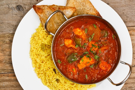 indian cooking: chicken jalfrezi a popular eastern curry sauce dish from india
