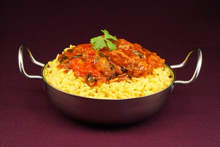 Beef Rogan Josh a popular indian curry with red pepper and spinach