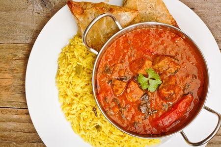 Beef Rogan Josh a popular indian curry with red pepper and spinach top view Standard-Bild