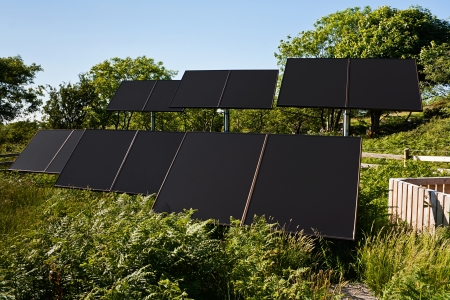 Small Solar farm in a rural countryside setting used to pump water for commercial agricultural use photo