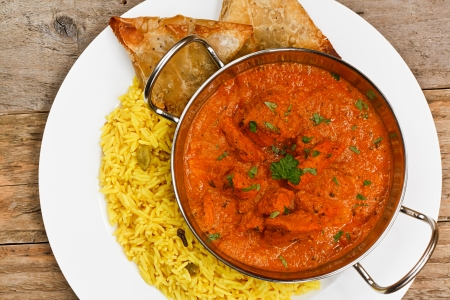 Chicken Tikka masala an indian curry popular developed in Europe as a fusion of Eastern food and modern western tastes photo